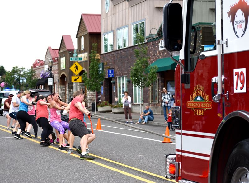 PMG FILE PHOTO: MATT DEBOW - The Bleeding Hearts Kettleball Club team competes in the first round of the 2018 Muscle Hustle firetruck pull.