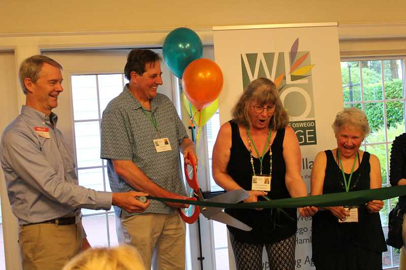 Left to right: Charlie Meyer, President of Villages NW, Ty Beckmann, marketing lead WLLO Village, Christine Kennedy, the chair of WLLO Village, and volunteer Judy Belk cut the ribbon to commemorate the opening of the WLLO Village.
