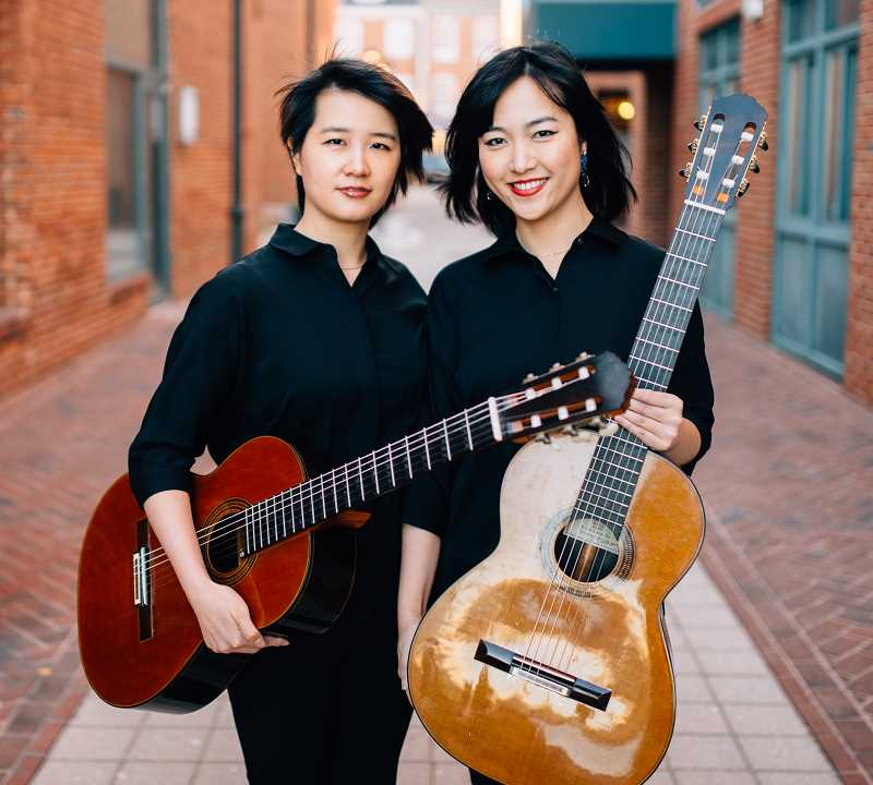 COURTESY PHOTO - Meng Su, left, and Yameng Wang, the Beijing Guitar Duo, will present a concert June 28 in the Eliot Chapel in Portland. The musicians will also conduct a master class Saturday, June 29 at 11 a.m. at Eliot Chapel.