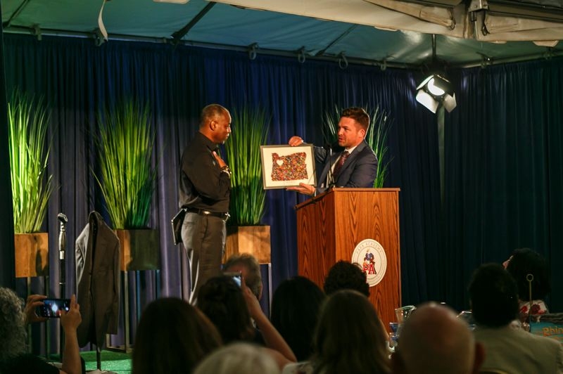 COURTESY PHOTO - LeVar Burton (left) accepts a gift of a student art project from Park Academy head of school Craig Lowery at the June 13 auction.