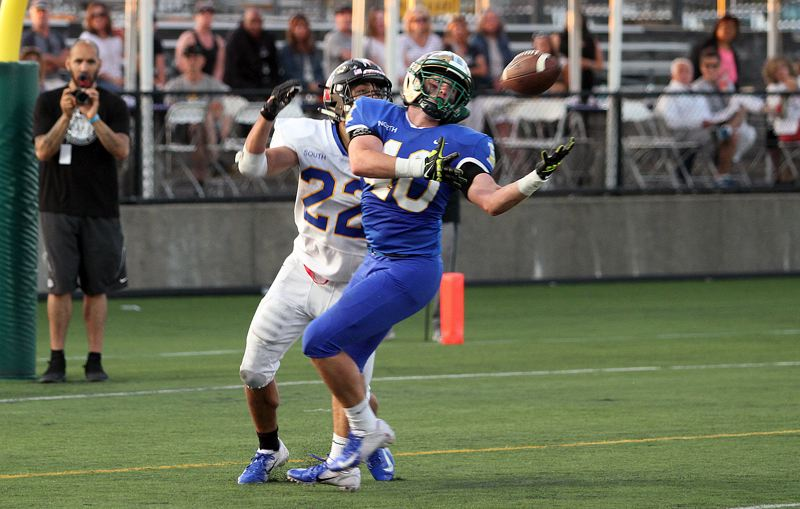 TIMES PHOTO: MILES VANCE - Jesuit senior linebacker Zach Carr made a big interception for the North in the Les Schwab Bowl.