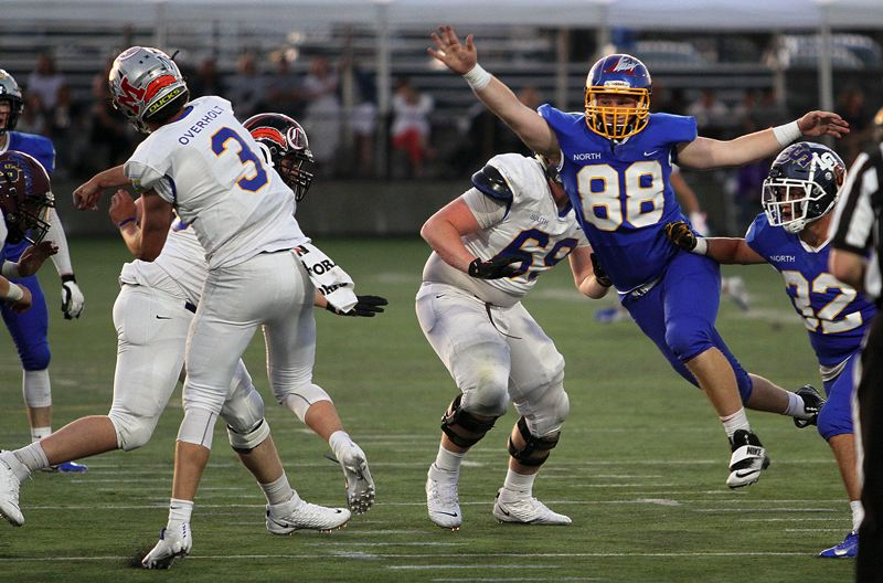 TIMES PHOTO: MILES VANCE - Aloha senior Elijah Vinzant applies pressure on the South quarterback in the Les Schwab Bowl.