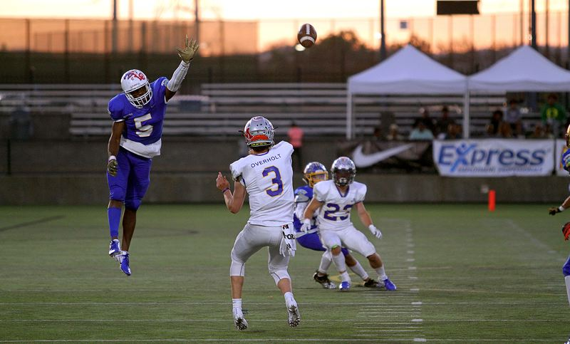 TIMES PHOTO: MILES VANCE - Sunset senior Marve Nyembo tries to deflect a pass in the Les Schwab Bowl last weekend.