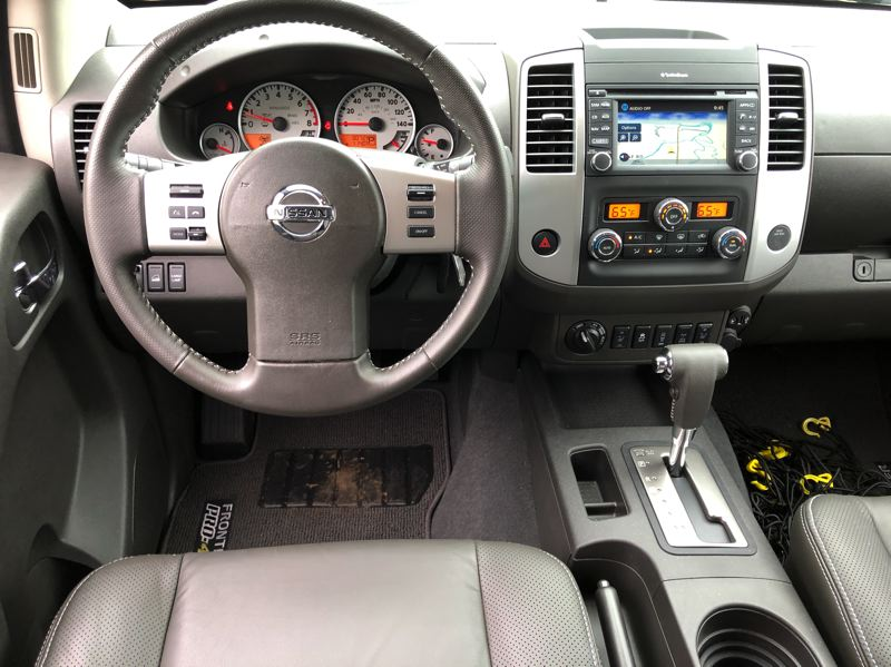 PMG PHOTO: JEFF ZURSCHMEIDE - The interior design of the 2019 Nissan Frontier is straight-forward but can be ordered will practically every advanced technology.