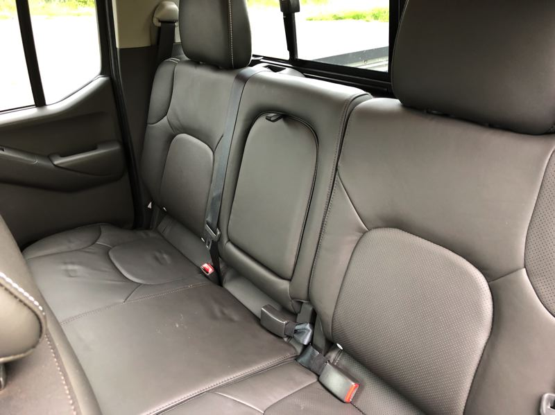 PMG PHOTO: JEFF ZURSCHMEIDE - Crew cab versions of the 2019 Nissan Frontier can carry three adults in the back seats.