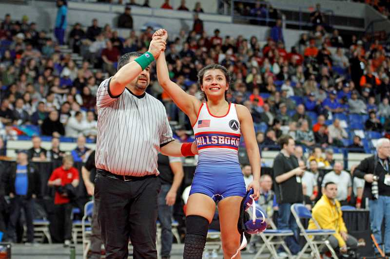 PMG PHOTO: WADE EVANSON - Hillsboro's Ayana Medina raises her hand in victory following her state championship win at the OSAA State Wrestling Championships this past winter at the Memorial Coliseum.