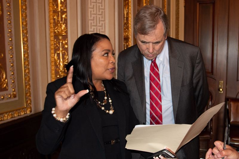 CONTRIBUTED - Loretta Smith showing Oregon U.S. Sen. Jeff Merkley picture from a previous Chinese dog meat festival in Washington DC.