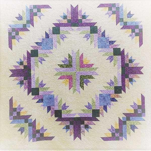 """PHOTO COURTESY OF TERRY HUNTER   - Members of the Crook County Quilt Guild made this quilt, which will be raffled off during the 22nd Biennial Country Quilt Show of Prineville next weekend. The pattern is called """"Burst"""" by Quilt Addicts Anonymous."""