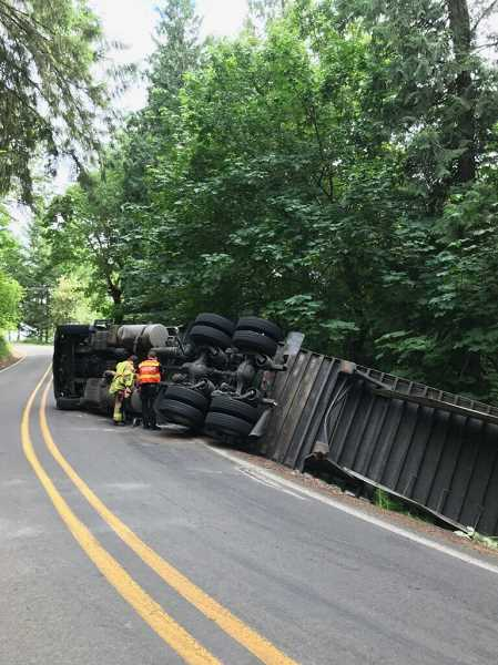 TUALATIN VALLEY FIRE AND RESCUE  - A semi trucked rolled over on Advance Road in the Stafford area Wednesday afternoon.