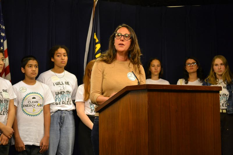 CLAIRE WITHYCOMBE/OREGON CAPITAL BUREAU - Tera Hurst, executive director of Renew Oregon, speaks to reporters, backed by youth who support House Bill 2020, after Republicans were no-shows at Thursday's meeting of the Oregon Senate to delay the vote.