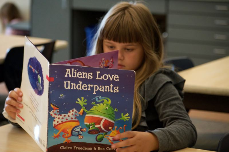 PMG PHOTO: CLARA HOWELL  - Third grader Addison Reinke participates in the summer reading program at Boones Ferry Primary.