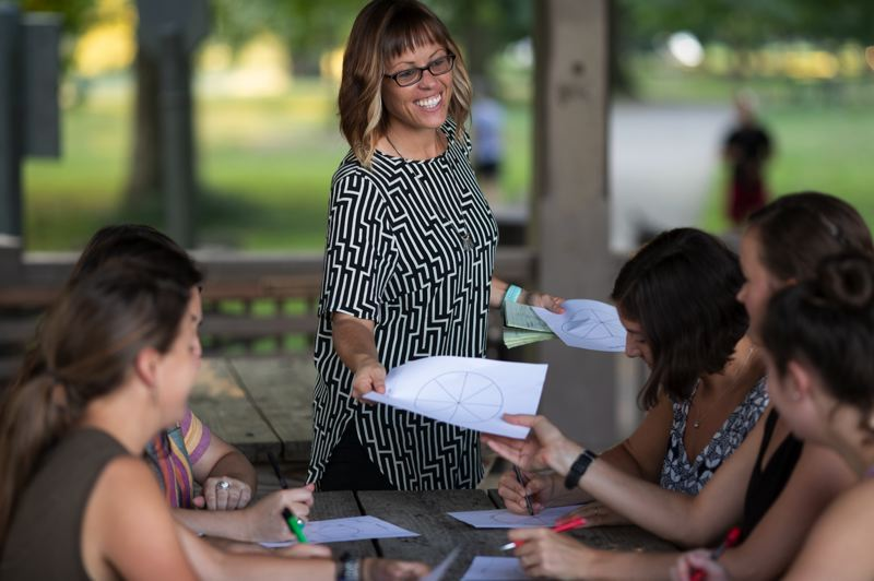 COURTESY: DUSTIN ALTON STRUPP/THE COURIER JOURNAL - Organizational psychologist Cara Meyer leading an activity for a Womens Empowering Leadership Workshop in Cherokee Park, Louisville, Kentucky.