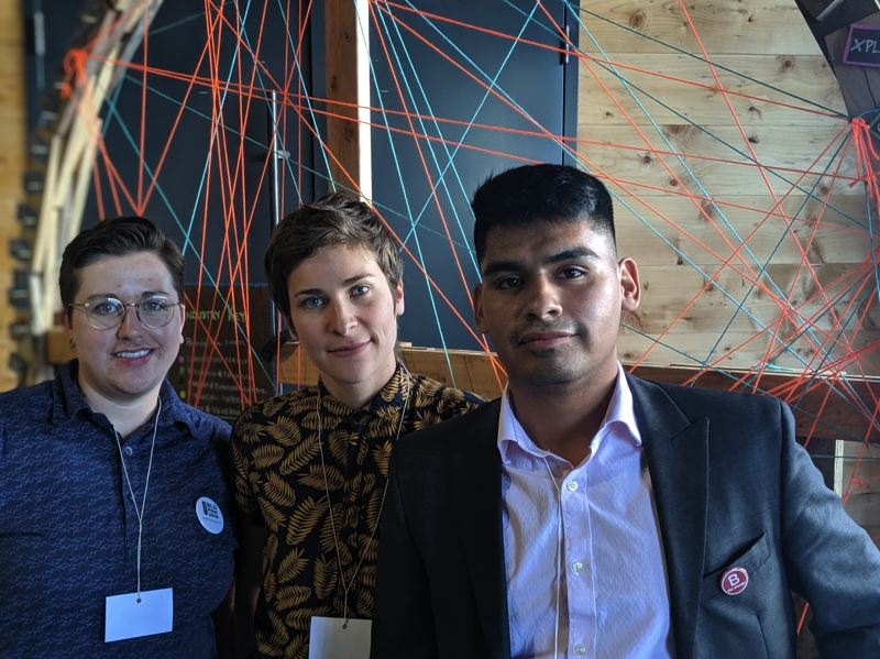 PMG: JOSEPH GALLIVAN  - (l-r) Kelsey Moody, commercial sales manager at the Joinery, Danya Rose-Merkle, an innovation strategist at Werk and Manny Barragan, a client and treasury representative from Beneficial Bank standing in front of the Mapping the B Ecosystem art project.