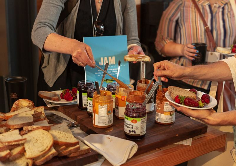 PMG: JOSEPH GALLIVAN  - Jam today: Attendees grab a snack at the B Corp Leadership Development Pacific Northwest Conference at the Redd in Southeast Portland June 13. Food came from vendors in the west part of the Redd, which is a food distribution hub as well as a venue.
