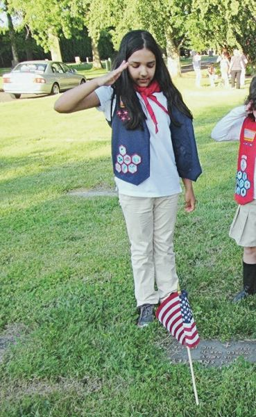 COURTESY PHOTO: OREGON CONNECTIONS ACADEMY  - Emily Pascu and her American Heritage Girls troop planted American flags on the graves of about 100 military veterans on Memorial Day at the Douglass Cemetery in Troutdale.