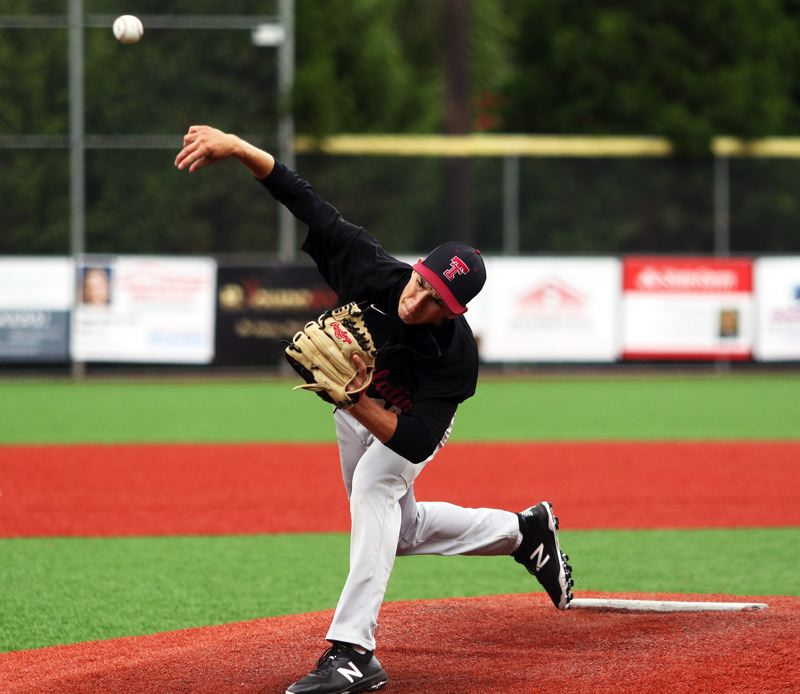 PMG PHOTO: DAN BROOD - Tualatin's Luke Rogers fires in a pitch during the first inning of the Wolves' 3-0 win over La Salle during Thursday's Lake Oswego tournament opener.