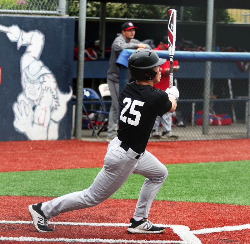PMG PHOTO: DAN BROOD - Tualatin's Griffin Biggs takes a swing during the Wolves' 3-0 win over La Salle in Thrusday's game at the Lake Oswego tournament.