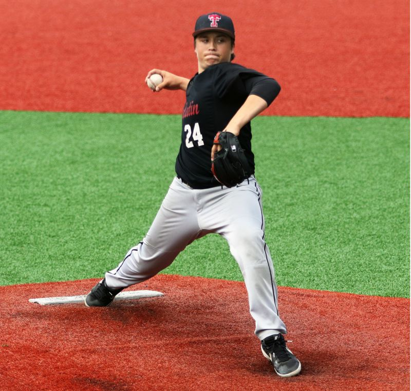 PMG PHOTO: DAN BROOD - Tualatin's Max Krahnke gets ready to throw a pitch during the Wolves' 3-0 win over La Salle in Thursday's game.