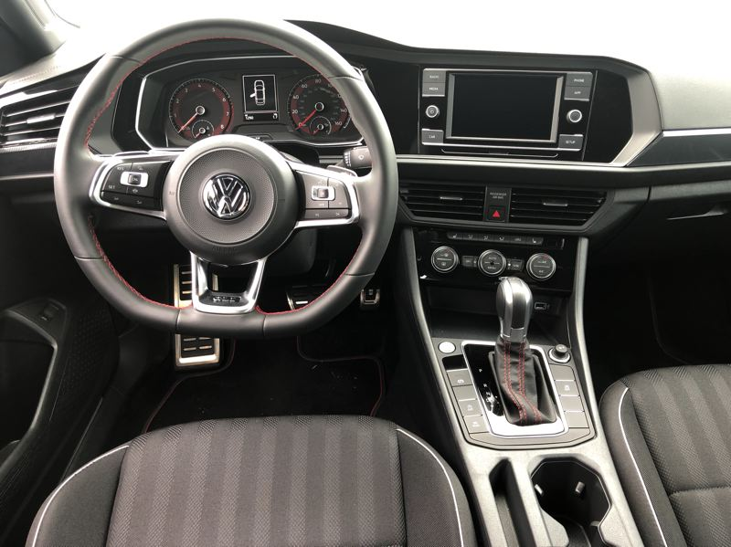 PMG PHOTO: JEFF ZURSCHMEIDE - Inside, the Jetta GLI lives up to its promise of a near-luxury performance sedan, with several infotainment and trim choices.