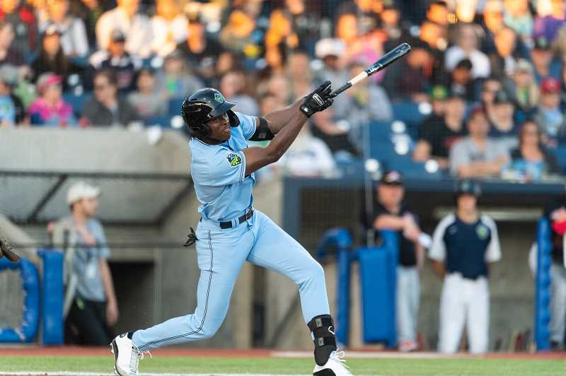 PMG PHOTO: CHRISTOPHER OERTELL - Hillsboro's Krisitan Robinson takes a swing during the Hops' 2019 home opener versus Vancouver Friday, June 21, at Ron Tonkin Field in Hillsboro.