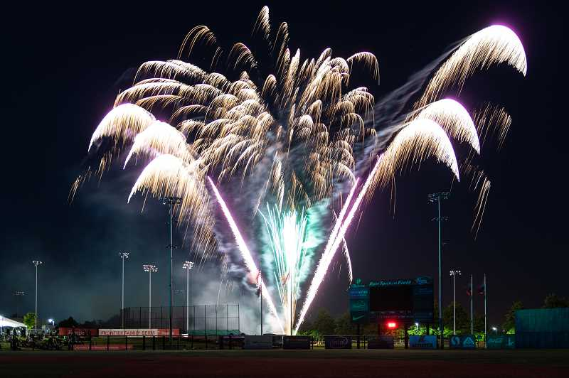 PMG PHOTO: CHRISTOPHER OERTELL - Fireworks light up the sky shortly following the Hops' 2019 home opener versus Vancouver Friday, June 21, at Ron Tonkin Field in Hillsboro.