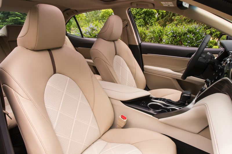 COURTESY TOYOTA MOTOR SALES - The front seats in the roomy 2019 Toyota Camry Hybrid are comfortable enough for long trips.