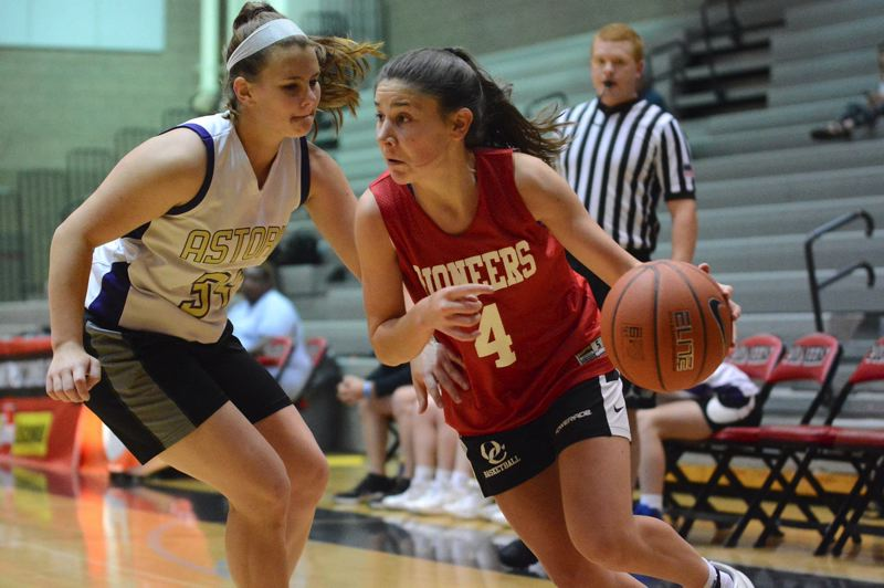 PMG PHOTO: DAVID BALL - Oregon Citys Kaydyn Guelsdorf drives baseline against Astorias Julia Norris during the teams 44-43 loss in Sundays Division 2 championship game at the Les Schwab Northwest Basketball tournament.