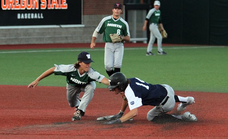PMG PHOTO: MILES VANCE - Wilsonville's Trevor Antonson tries to tag out out the South's Decker Stedman at second base during the North team's 13-10 loss to the South in the Oregon All-Star Series on Saturday at Goss Stadium in Corvallis.