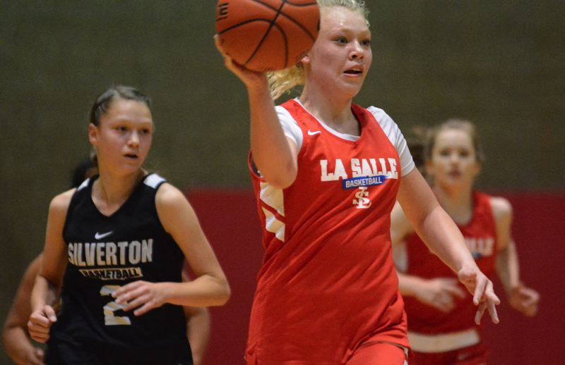 PMG PHOTO: DAVID BALL - La Salle Prep point guard Emily Niebergall prepares to send a pass ahead on a fast break during the Falcons 66-39 first-round win over Silverton on Friday.