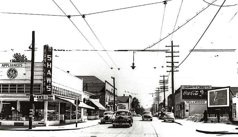 COURTESY SMILE HISTORY COMMITTEE - This is 13th Avenue, looking south from Tacoma Street, in the 1940s. Shaws Furniture Company on the left, and at right, Hatchers Chevron Station - at a time when you could find a gas stations at many intersections. The Ardmore Candy Company is in the second-story building on the right, and you might just be able to see THE BEEs office in the small building with the awning on the left.