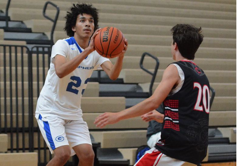 PMG PHOTO: DAVID BALL - Greshams Isaiah Clinton squares up for a 3-pointer during the team's 64-42 win over Camas on Friday.