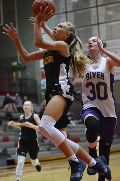 PMG PHOTO: DAVID BALL - Barlows Kennedie Shuler goes up for a layin during the Bruins 57-37 win over Columbia River in the first round of the Les Schwab Northwest Championships on Friday.