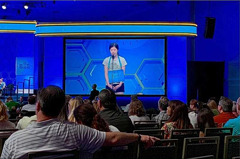COURTESY OF ELLEANOR CHIN - Winterhaven Schools champion speller, Agatha Chan, nails the letters spelling ratafia, a type of almond-flavored cookie, to achieve entry into the third round of this years Scripps National Spelling Bee in Washington DC - broadcast nationally in May by ESPN.