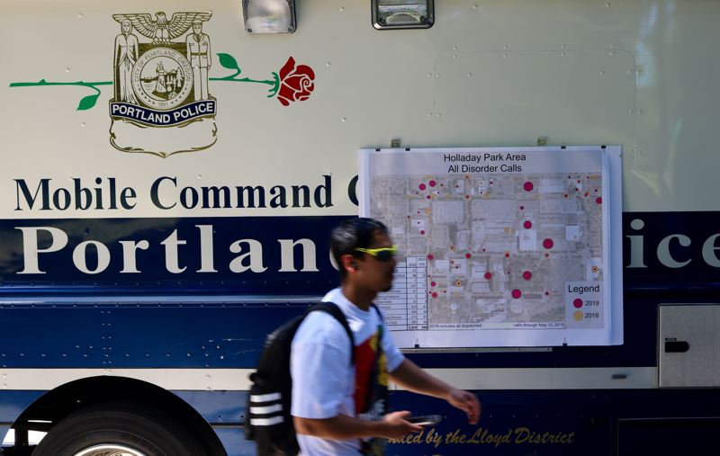 PMG PHOTO: ZANE SPARLING - A person walks past the Portland Police Bureaus mobile command unit, which was parked outside Holladay Park in the Lloyd District for a free community cookout Wednesday, June 12.