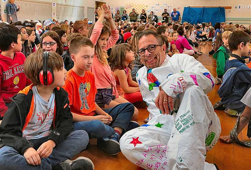 DAVID F. ASHTON - Dressed in a Buzz Lightyear suit, Llewellyn Elementary Principal Joe Galati relaxes with the students before his last student assembly at the school.