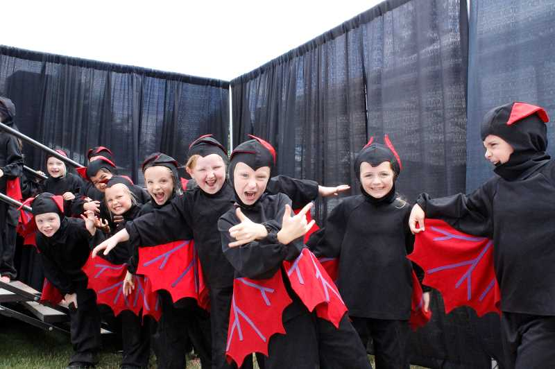 PMG PHOTO: AVA EUCKER - Bats bare their teeth backstage during a dress rehearsal.