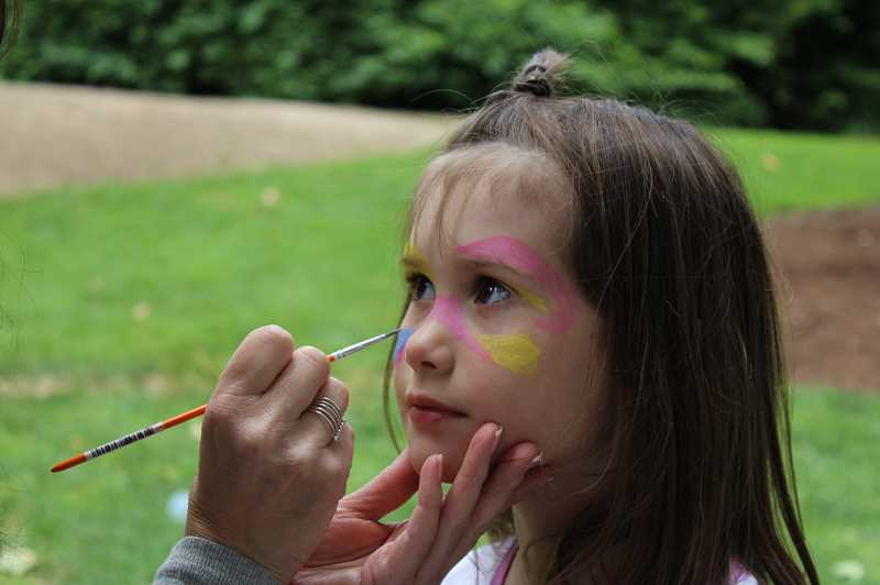 PMG PHOTO: AVA EUCKER - Many faces were colorfully painted at the arts fesival.