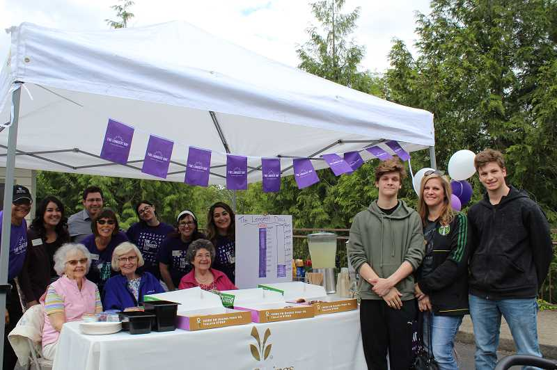 PMG PHOTO: AVA EUCKER  - Family and friends gather to support Alzheimer's fundraising.