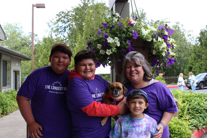 PMG PHOTO: AVA EUCKER - From left, Josiah, Jeremiah, Selma the dog, Jacob and Ruth Lago gather to support The Springs and the fundraising event.