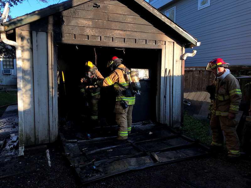 COURTESY PHOTO: LAKE OSWEGO FIRE - A fire was contained to a garage early Monday morning near downtown Lake Oswego.