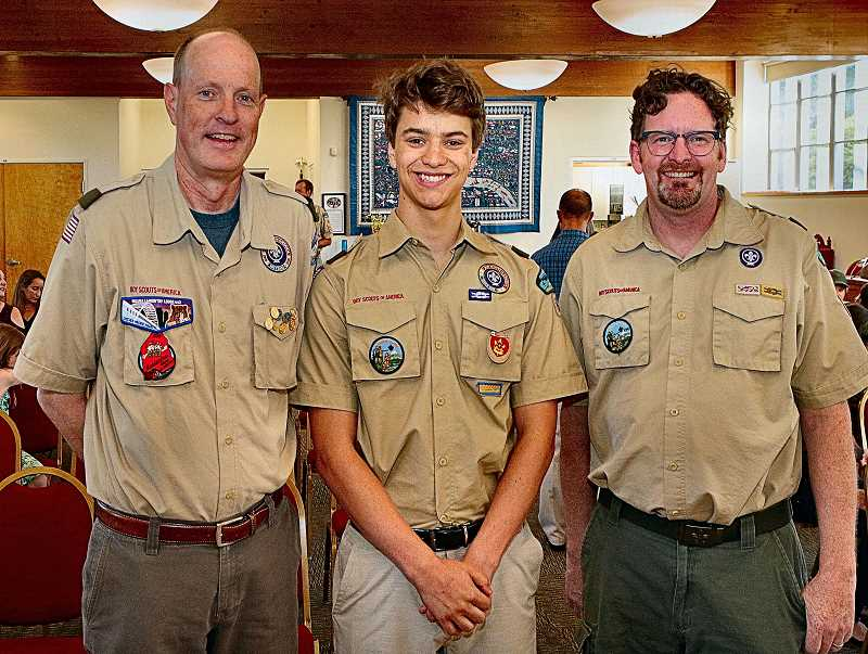 DAVID F. ASHTON - Assistant Scoutmaster Tom Armstrong joins new Eagle Scout Alexander Hart and Scoutmaster Eric Meren for a celebratory photo.