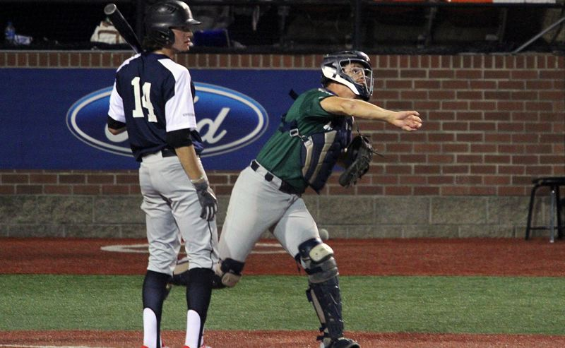 PMG PHOTO: MILES VANCE - Lake Oswego catcher Gabe DeVille makes a throw during Saturday, June 22, action at the Oregon All-Star Series at Goss Stadium in Corvallis.