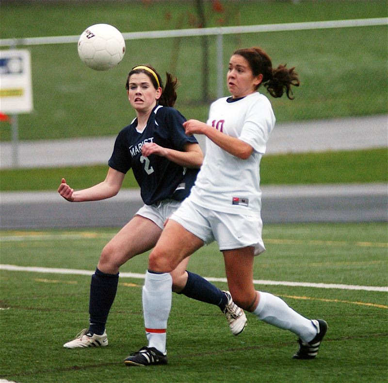 PMG FILE PHOTO: DAN BROOD - Daniela Solis (right) battles for the ball when she played for the Sherwood High School girls soccer team during a Class 5A state playoff match in 2010.