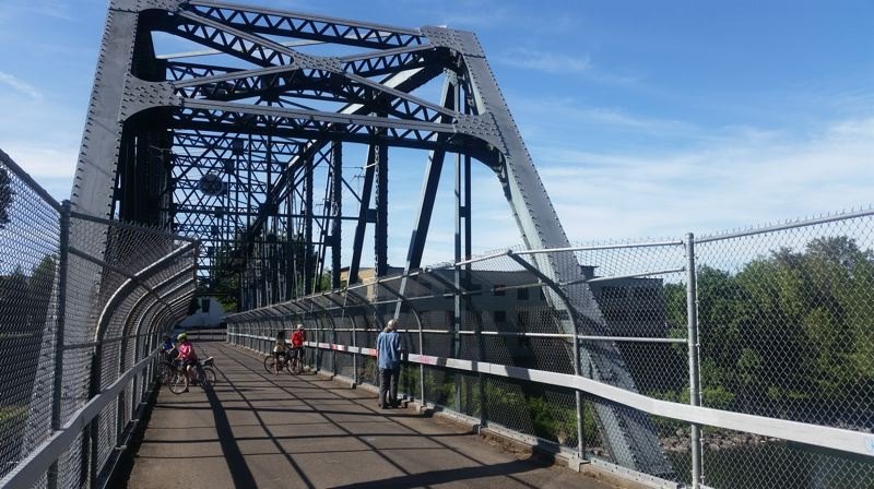 PMG PHOTO: RAYMOND RENDLEMAN - A bridge at the end of 82nd Drive in Gladstone is a popular crossing of the Clackamas River for people walking and biking into Oregon City.
