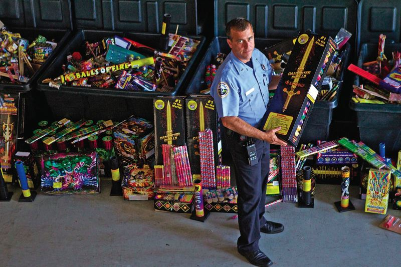 TRIBUNE PHOTO: KEVIN HARDEN - Each year, thousands of illegal fireworks are seized by local law enforcement. Here, Portland Fire & Rescue Public Education Officer Michael Silva holds one of the 45,000 illegal fireworks that he collected last year. The fireworks were sent to an undisclosed location in November to be destroyed., Portland Tribune - Health  Keep it legal, keep it safe this holiday
