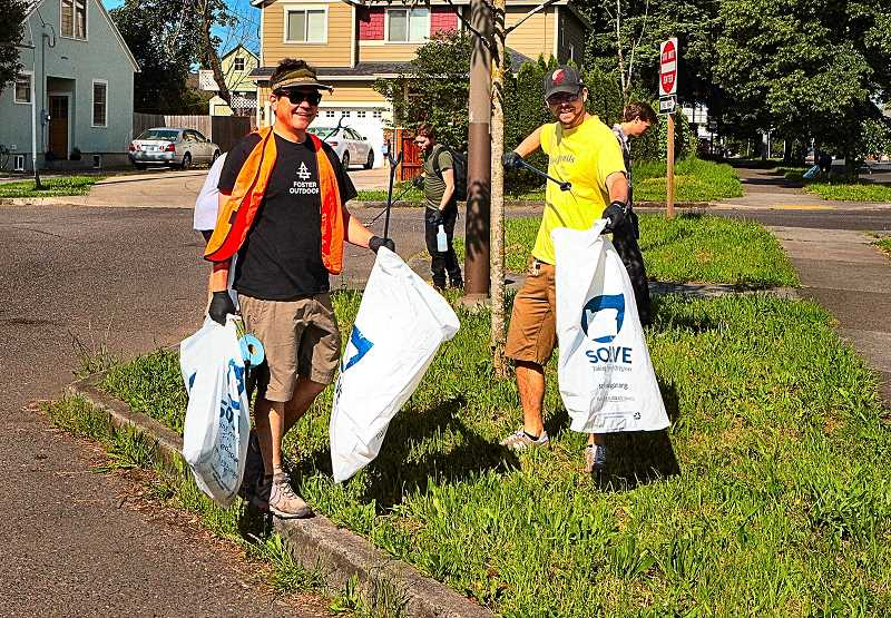 DAVID F. ASHTON - Cheered by the unexpectedly large turnout of volunteers to the neighborhood clean-up were Foster-Powell Neighborhood Association Chair Eric Furlong, at left, and volunteer Chris Galvin.
