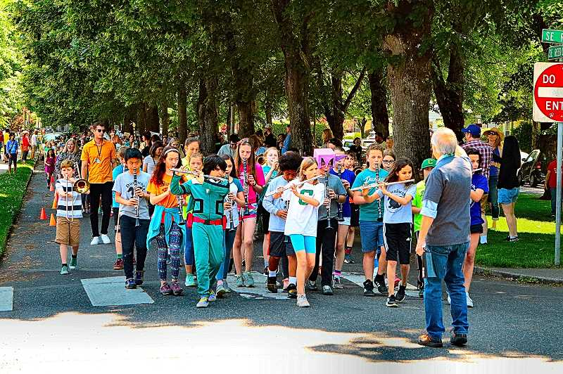 DAVID F. ASHTON - Led this year by their own school band, the Duniway Elementary annual Spring Parade stepped off for its march around Eastmoreland.