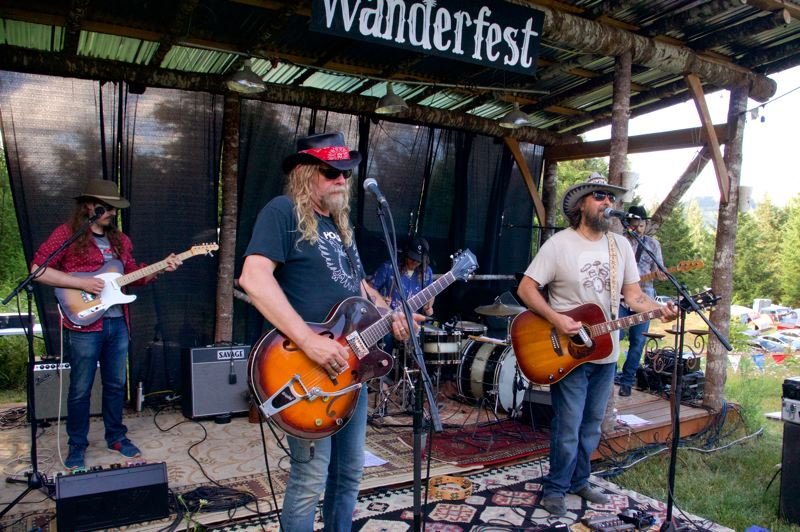COURTESY PHOTO: LOREN LEED - Wanderband, the unofficial house band for the third-annual Wanderfest held this weekend at Dundee Lodge near Gaston, features (from left) Tate Peterson, festival organizers Kris Stuart and Matt Cadenelli, and Bob Dunham