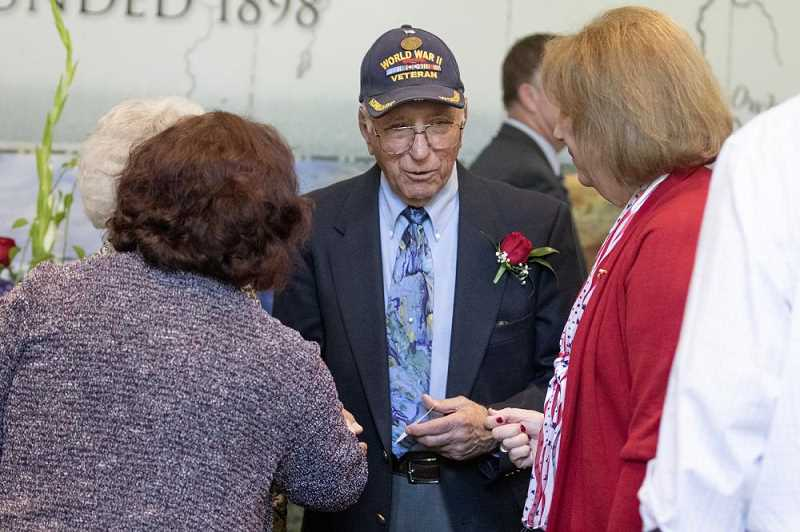 Abe Laurenzo chats with supporters after giving his first-hand impressions of D-Day during the Celebration of Heroes event.