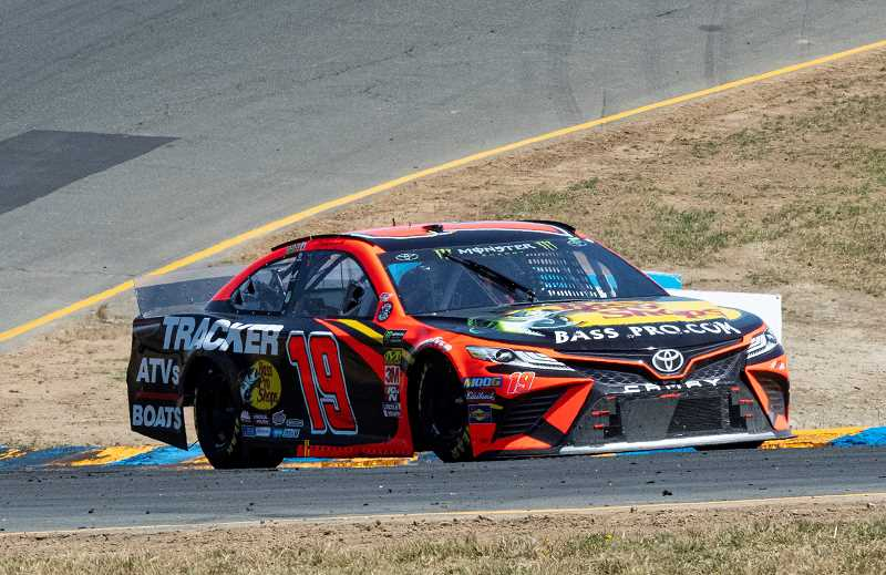 LON AUSTIN/CENTRAL OREGONIAN - Martin Truex Jr. rounds turn three at Sonoma International Raceway on Sunday. Truex won the race. It was his second consecutive win at Sonoma and his fourth win of the year.